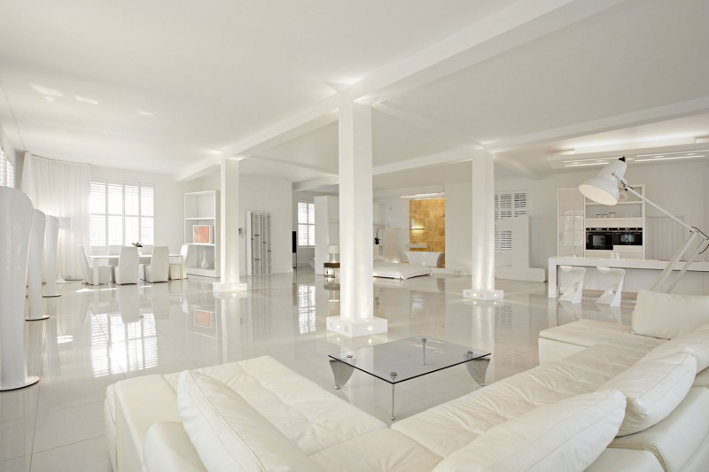 Use white furniture to emphasize the openness and airiness of an open plan living room