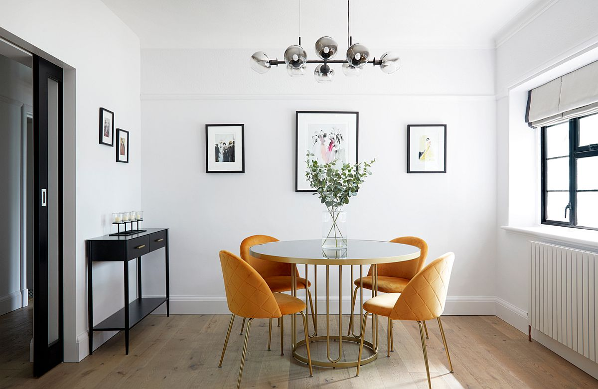Delightful modern dining room with round white and gold dining table and four yellow chairs 71314 - Black, White and Brilliant Pops of Yellow Revitalize Old Epsom Apartment