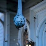 Spider eggs on the porch hanging 150x150 - Scary Halloween Decorations That'll Give You The Jitters