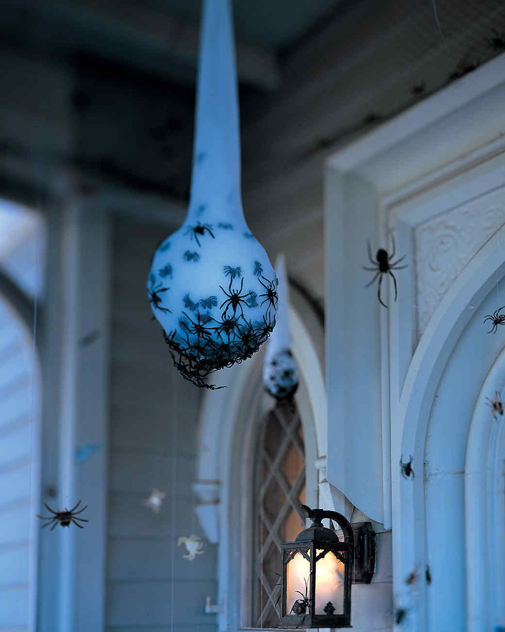 Spider eggs on the porch hanging - Scary Halloween Decorations That'll Give You The Jitters